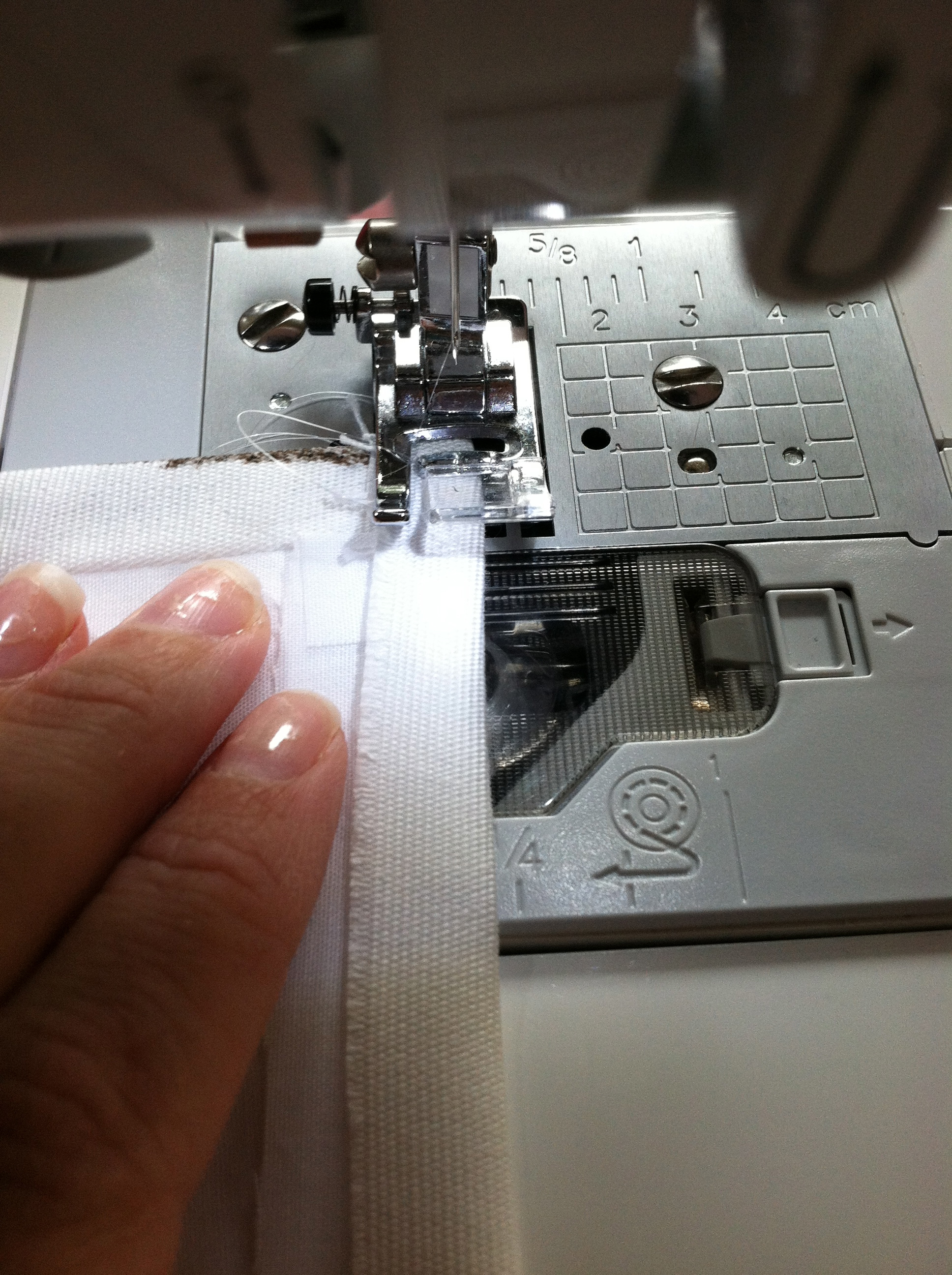 "press and stitch a 1/2"" hem sewing close to the edge"
