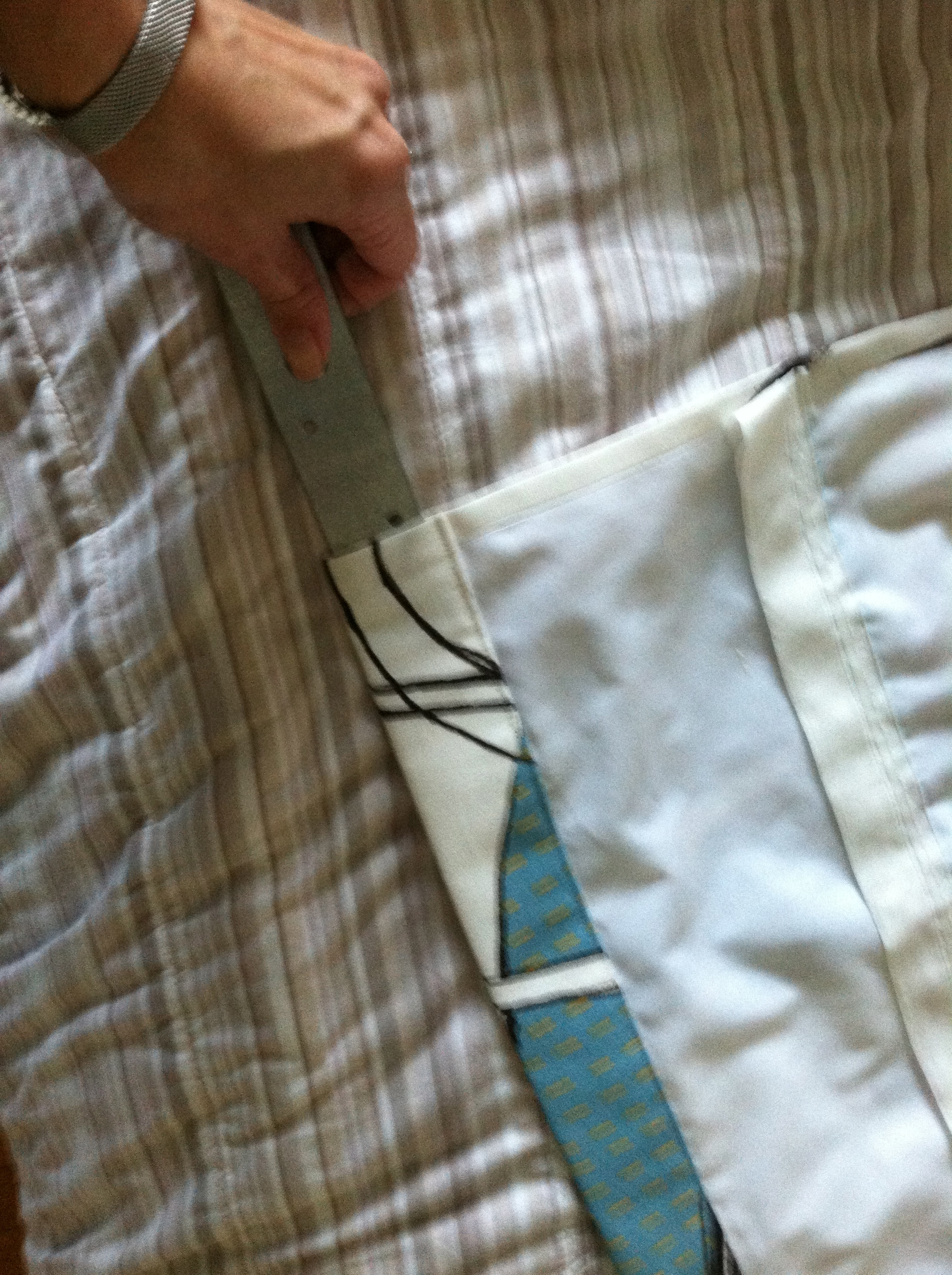 Insert Weight Rod into hem casing and sew shut